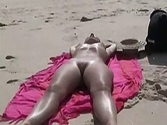 Voyeur nymph on beach