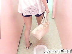 Insane Japanese cuties play urinating in public toilet