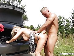 Grandma changes flat tire and leans over for some young cock