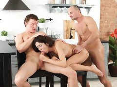 Lovely brunette Katty has a scorching threesome in the kitchen