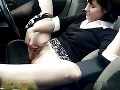 Filthy mature bi-atch fingers her cooch hole on the back seat of her camper
