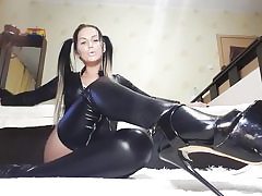 Hot bitch on high heels and leather costume caressing her nasty snatch crevasse