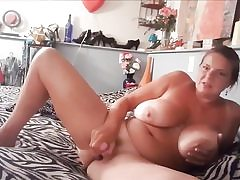 Insane mature whore with large melons masturbating her pussy hole