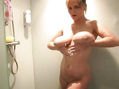 Blonde sweetheart with hefty fun bags takes a sensual shower all alone
