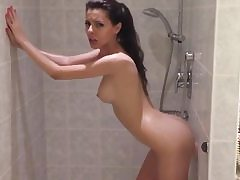 Indeed molten girl is taking shower and is fucking her pussy with dildo